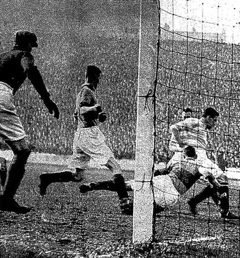 McGrory slots the ball home in the Scottish Cup Final as the Motherwell defence try in vain to stop him.
